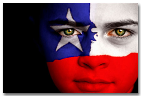 Portrait of a boy with the flag of Chile painted on his face.